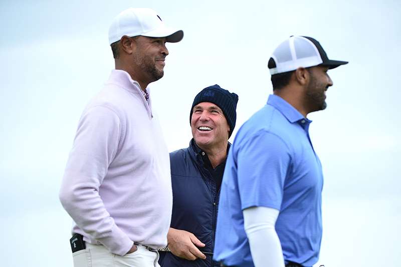 Shane Warne shares a joke with playing partners